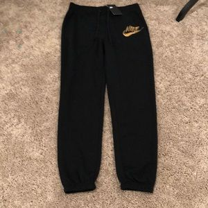Black Nike Jogger with Gold Swoosh Size M and XL